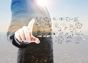 businessman-pointing-graphs-symbols_edit