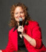kate speaking red jacket.jpg
