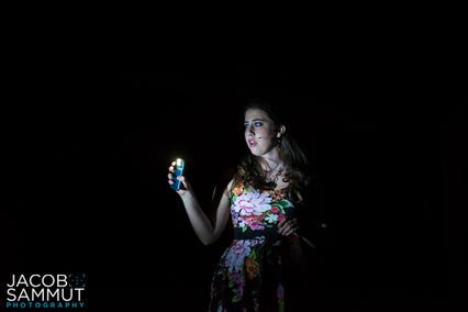 Lexy (Karen Decelis) exploring the dark rooms beneath the Manoel Theatre stage.