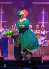 Alice is looked after by Nanny O'Beezwax (Malcolm Galea).