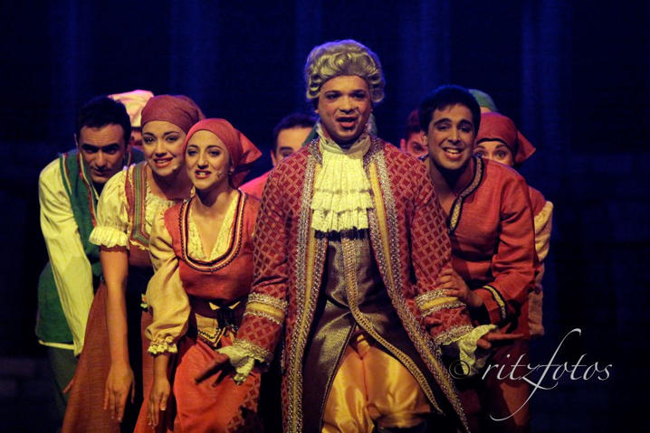 Muddles (Joseph Zammit) leads the villagers on a merry dance.