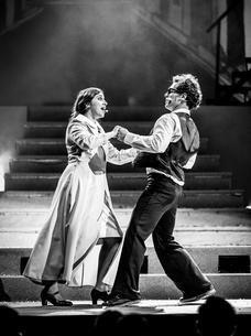 Lourdes (Amber Bondin) dances with Toni (Davide Tucci).