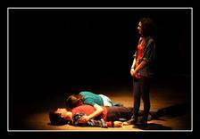 Cathy (Tina Rizzo) stands over the bodies of Romeo and Juliet (David Chircop & Vanessa Gatt)