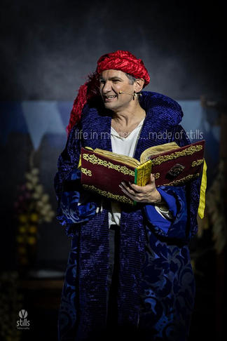 The panto Narrator (Malcolm Galea).
