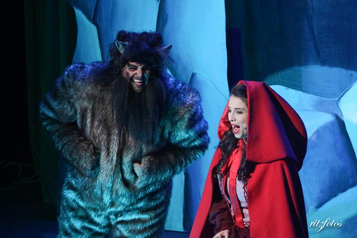 Little Red Riding Hood (Lisa Mifsud) runs into the Big Bad Wolf (Luke Dalli).