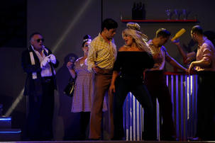 Alfred il-Kredu (Kevin Borg) dances with Georgette (Marilena Gauci).