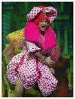 Malcolm Galea as Widow Twankey wearing a costume designed by Ernest Camilleri.
