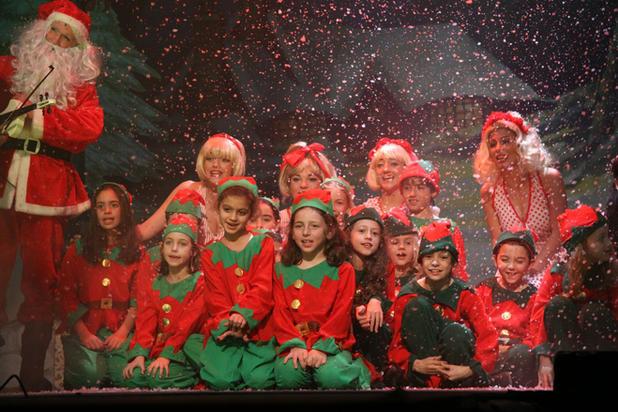 Santa Claus (Paul Cuschieri) makes a surprise visit with his Elves.