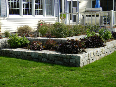 After: A crisp, clean stone wall/planter in South Dennis