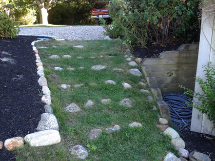 Before: Slippery steep slope in Eastham was the creation of an earlier landscaper
