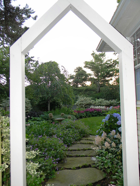 Arches in the garden are like portals to paradise