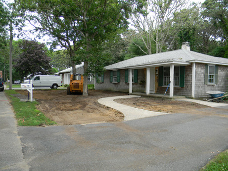Before: The owner of this Harwichport cottage wanted her whole front yard to be a garden.