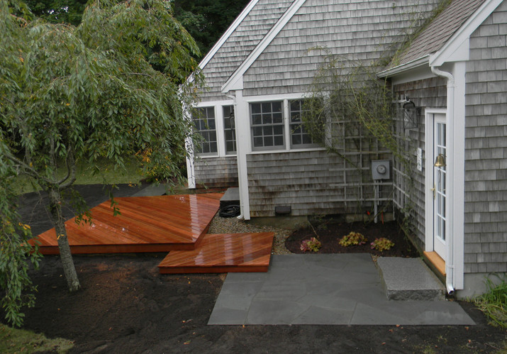 In-ground mahogany deck and bluestone terrace and step in West Barnstable