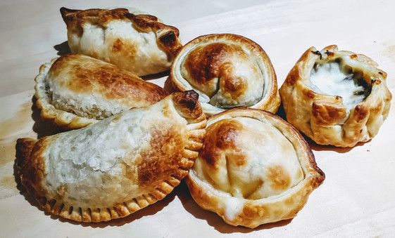 Baked Empanadas by dozen $ 29 Meat, Chicken, Ham & Cheese, Mushroom, Capresse or Spinach