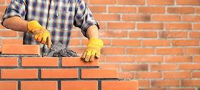 Bricklayer industrial worker installing