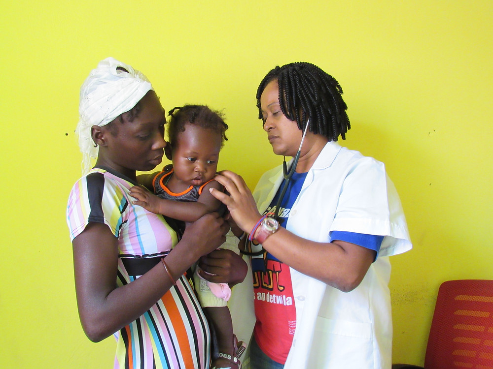 Dr. Gabrielle examines a baby from the community