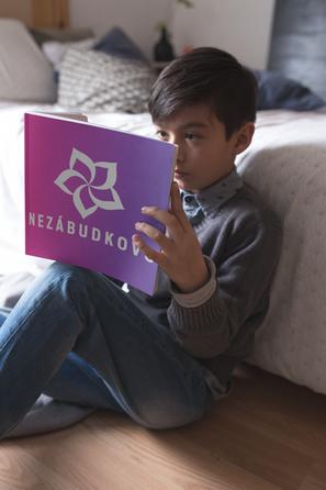 boy-reading-a-square-book-mockup-sitting