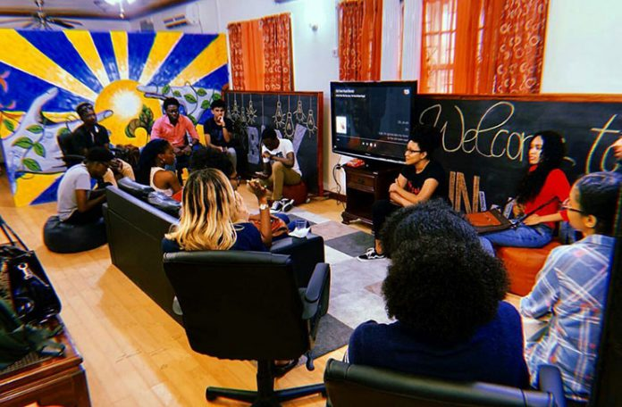 Artists discussing the execution of 'Filling the Void 2019' (Guyana Chronicle, 2019)