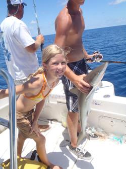 Girl catches shark on charter boat