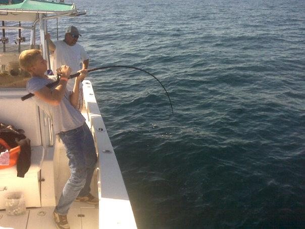Bent rod on Fishing Charter offshore