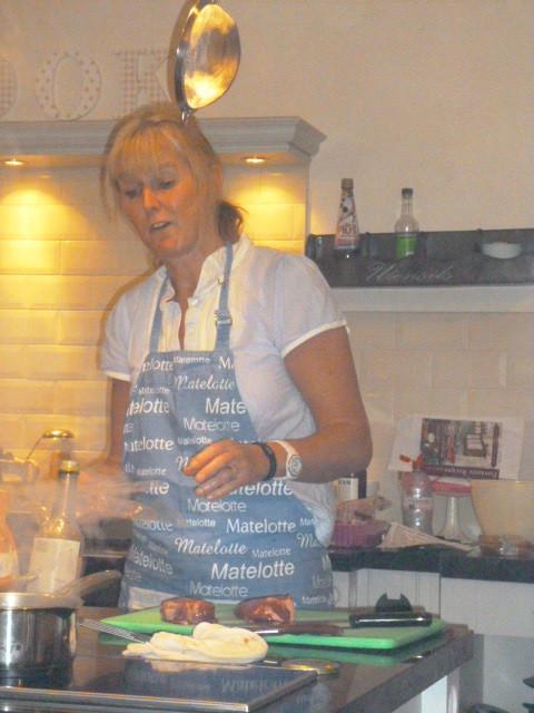 Charlotte demonstrating cookery skills