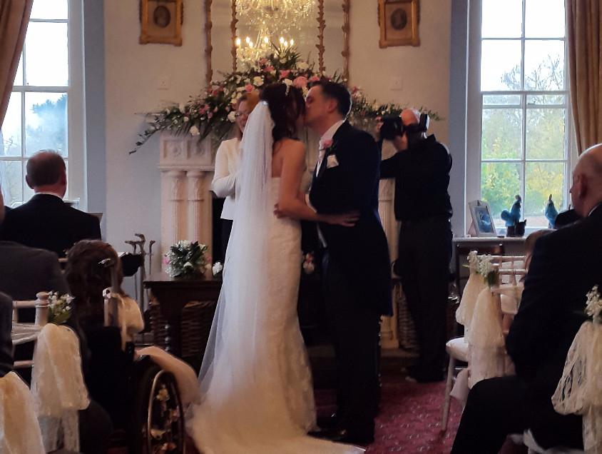 Happy couple at register 2015_edited.jpg