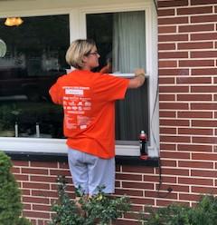 Mercy volunteer cleaning windows.jpg