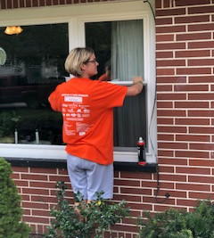 Mercy volunteer cleaning windows.jpg