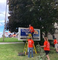 Mercy at UWTC cutting tree limbs.jpg