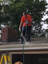 Mercy volunteer on roof.jpg
