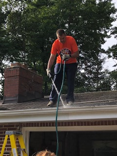 Mercy volunteer on roof.jpg