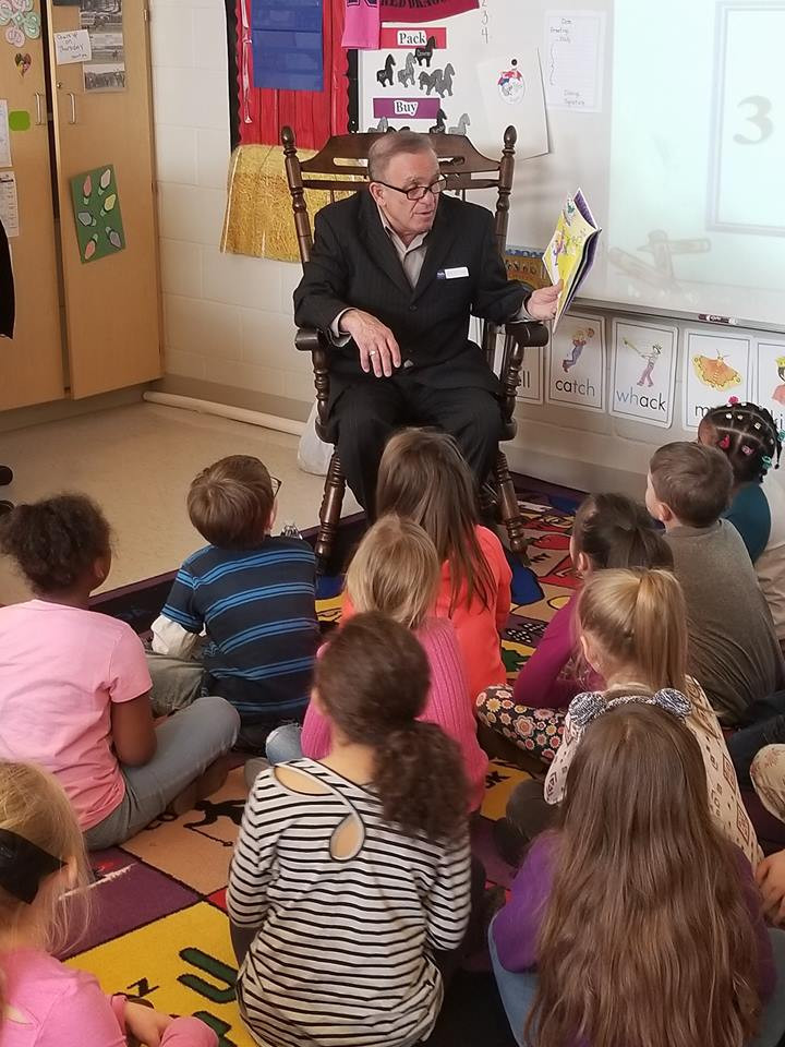 Commissioner Frank Fuda reads to Ms. Esp