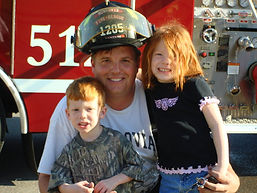 Dale with Monrovia fire and kids.jpg