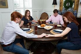 Family dinner praying .jpg