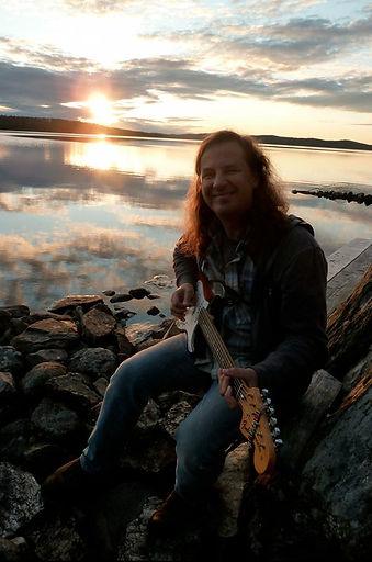 Jonathan Segel holding a Fender Stratocaster