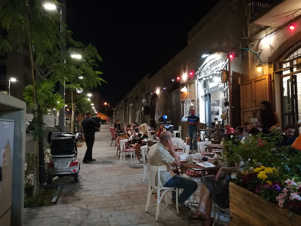 Wandering the street of the ancient port city of Jaffa during- greek music and great atmosphere!