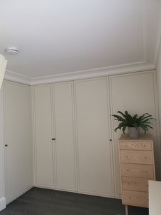L shaped Master wardrobe out of sprayed MDF