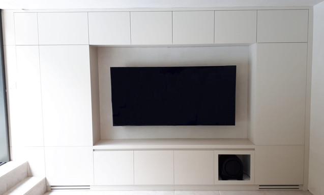 sprayed TV unit with integrated fridge freezer on its sides