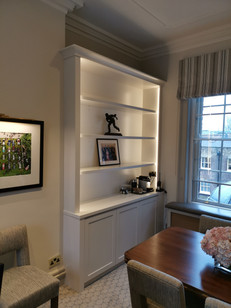 fitted sprayed bookcase cabinet with the shaker panel doors and strip lights around
