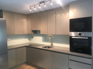 Kitchen out of high glass mdf and marble worktop