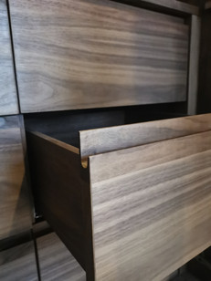 internal detail of master wardrobe with solid walnut drawer front