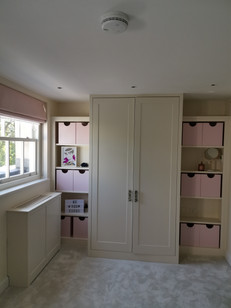 Sprayed wardrobe with shelves and storage boxes