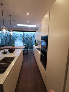 Kitchen out of sprayed moisture resistant mdf with marble worktop