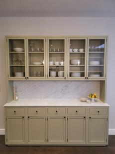 Kitchen dresser with shaker panel doors, rusty designed butt hinges and marble worktop & splashback