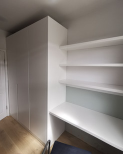 sprayed wardrobe with floating desk and shelves
