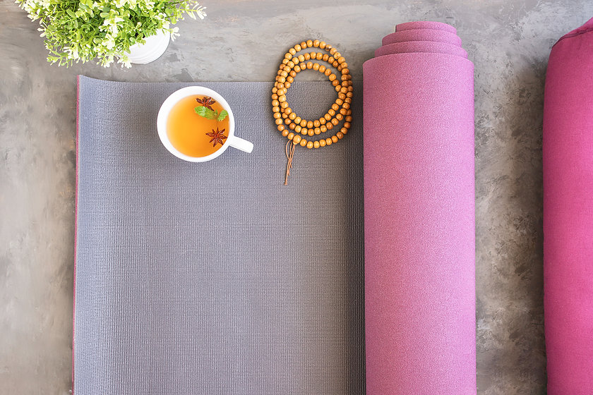 Open yoga mat and bolster for practice,