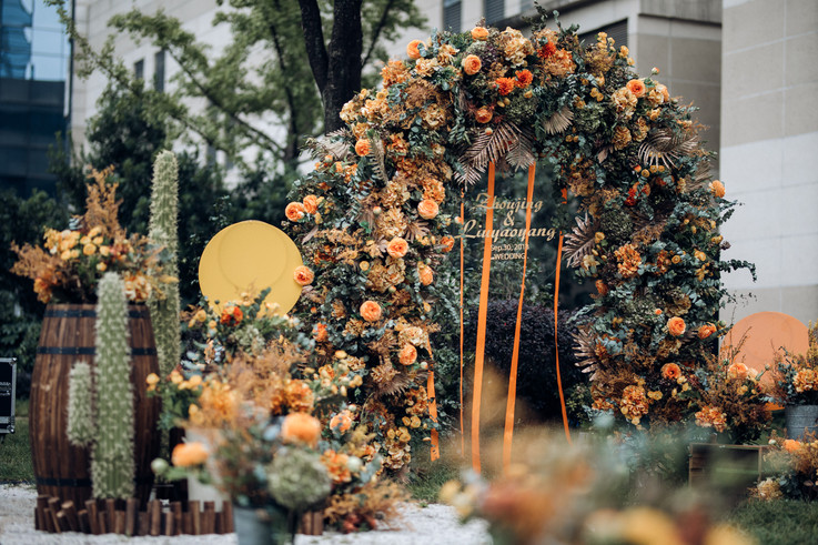 orange flower arch cactus outdoor wedding, ido events los angeles, chinese wedding and event planner