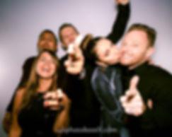 people having fun in a photo booth photo