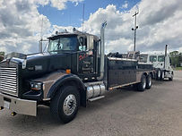 Del's 7035 towing a road tractor.jpg