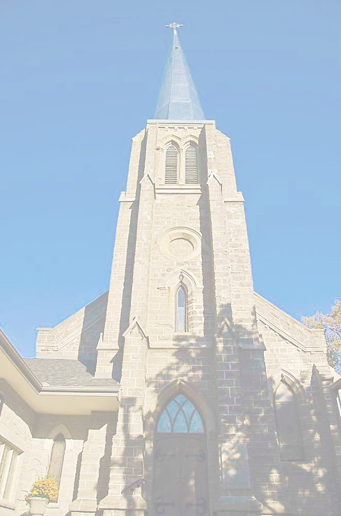 Front facade of St. John's Church --view of steeple and blue sky.